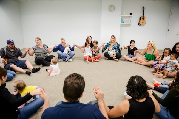 Families enjoy a Music Together class at Soulshine Arts.